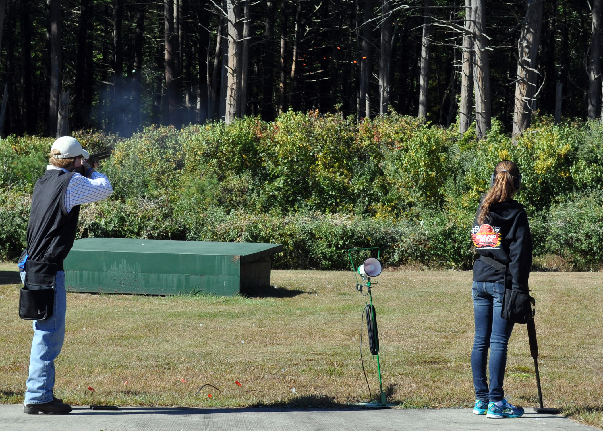 A student shoots while another looks on